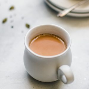 Close up of Authentic Pakistani Chai in a white teacup.