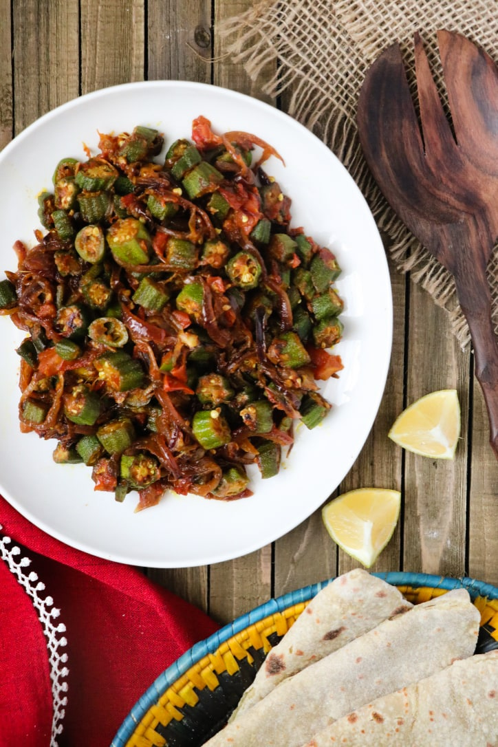 Okra and Onion Curry (Bhindi Pyaaz, or bhindi do pyaza) is a traditional Pakistani and Indian okra curry recipe that consists of stir-fried okra enveloped in a savory onion and tomato curry. This is naturally gluten-free and vegan curry that\'s been tested-and-perfected to ensure a perfectly balanced taste.