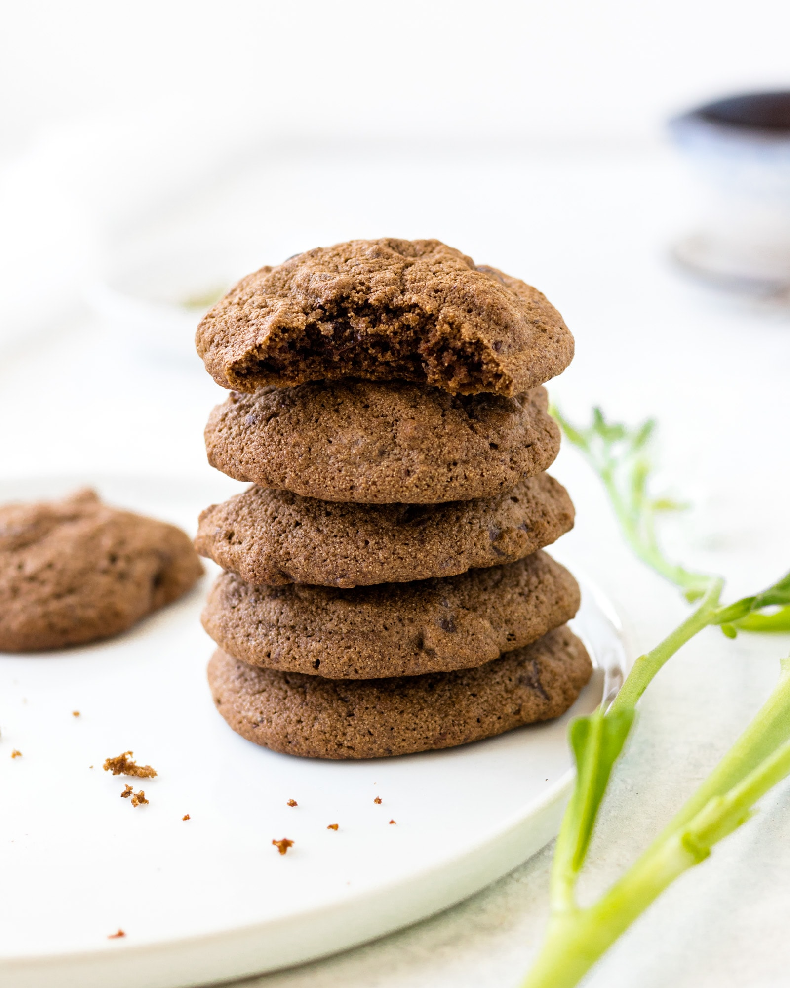 Stack of 5 Double Chocolate Cardamom Cookies with the top cookie partially eaten.