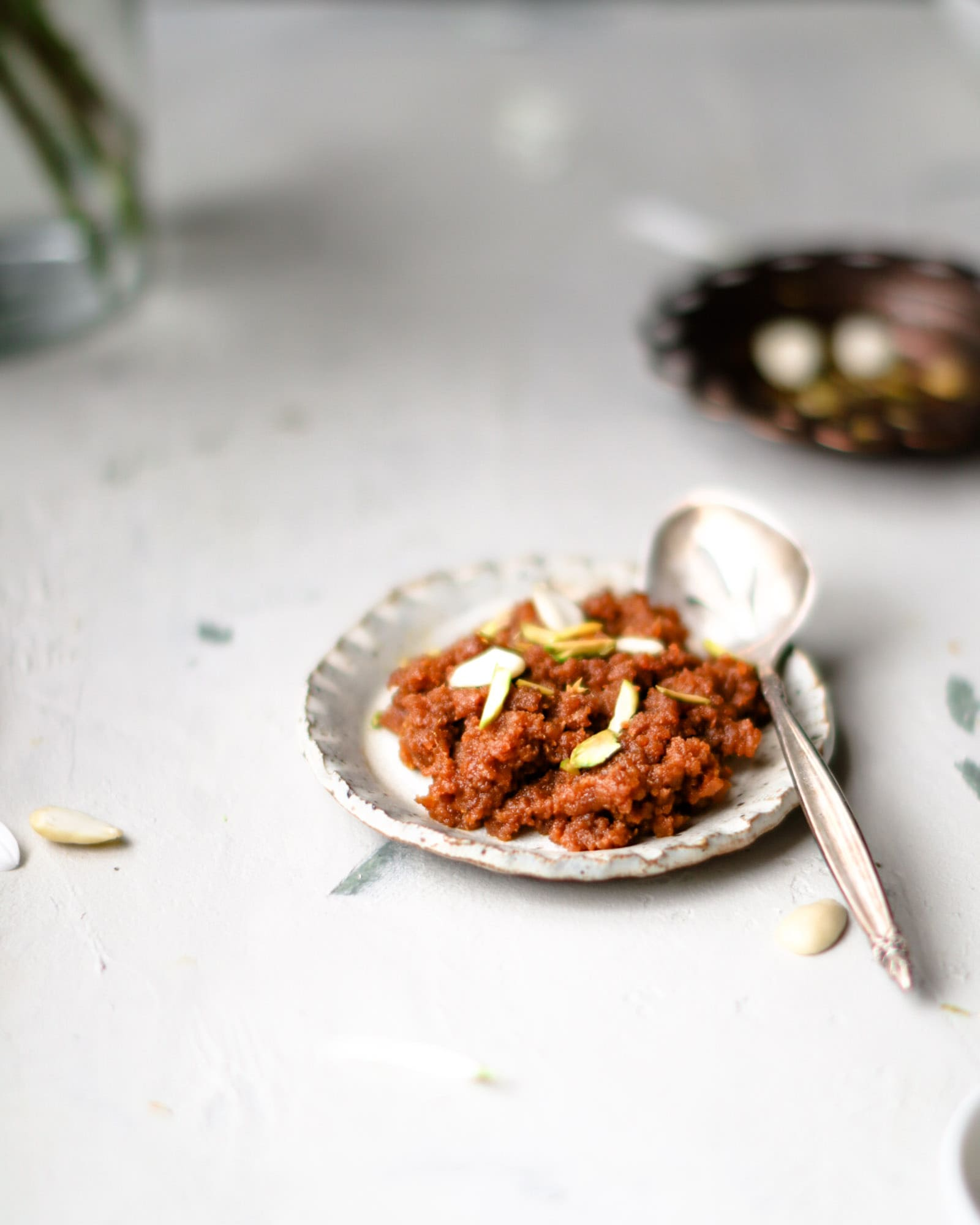 Instant Pot Carrot Halwa on a small plate with a silver spoon