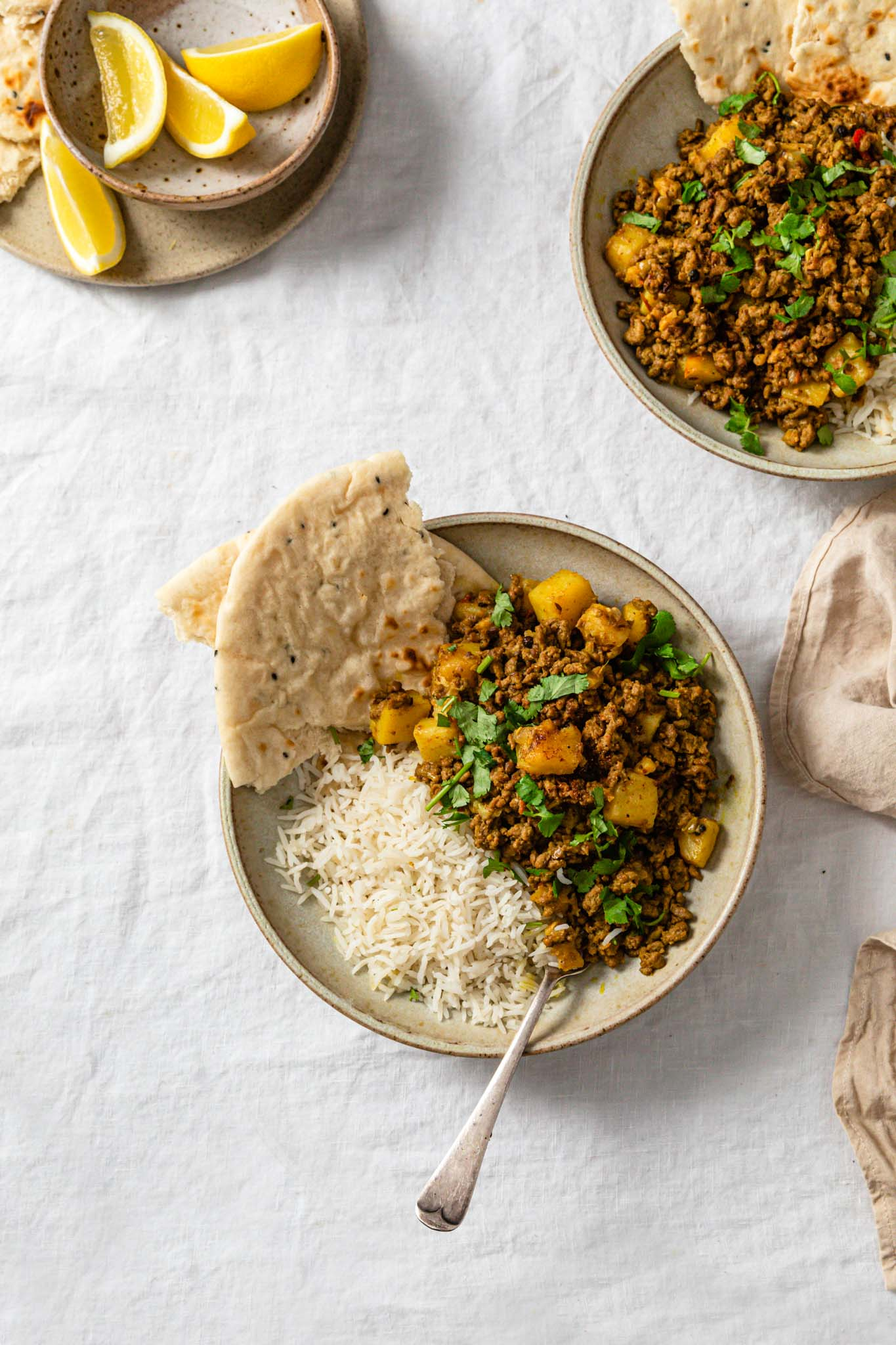 Ground Beef (Keema Aloo) Curry in a bowls with naan and basmati rice