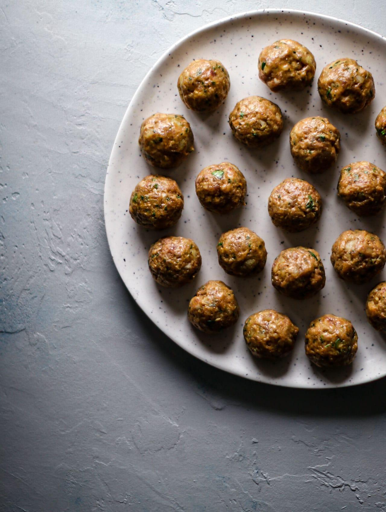 Uncooked Meatballs (Kofte) on a platter