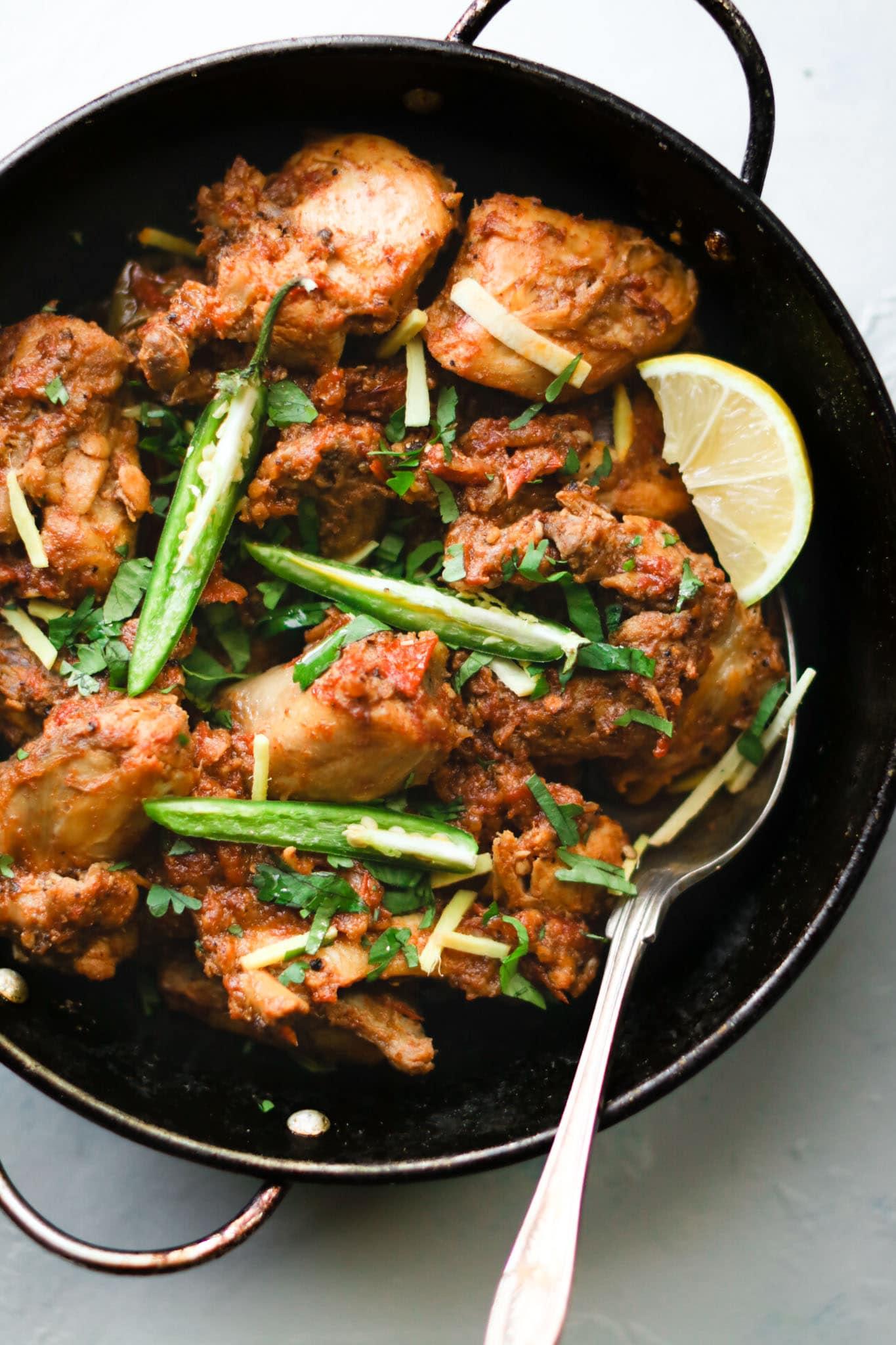 Close up of chicken karahi in a black karahi