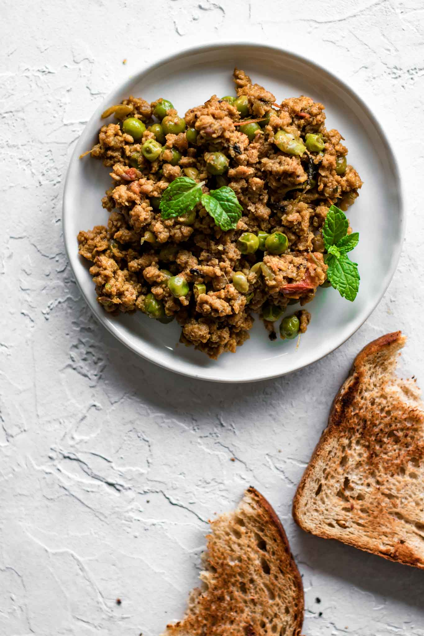 Keema Matar on a plate with toasted bread