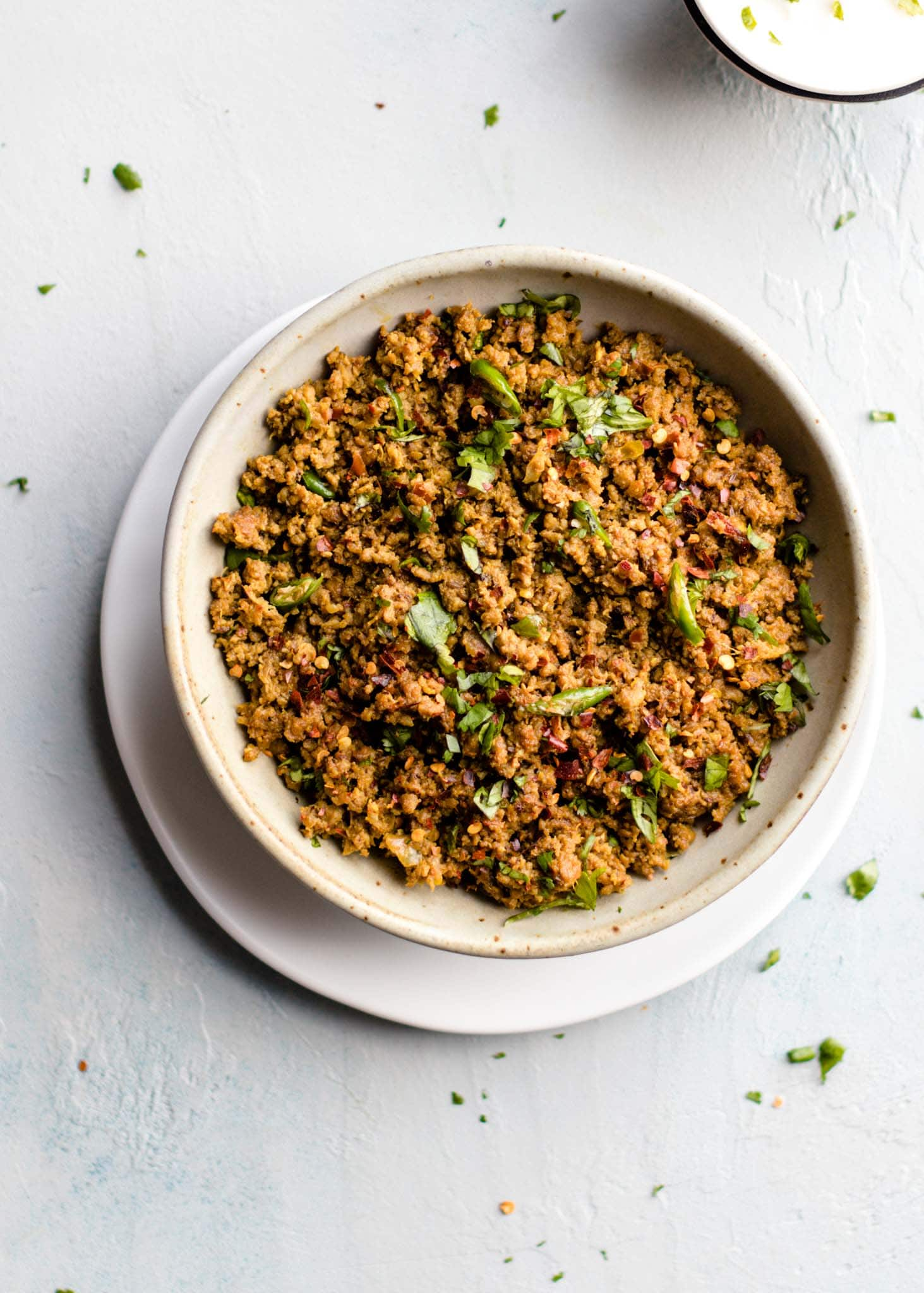 Keema in a bowl with cilantro sprinkled on top
