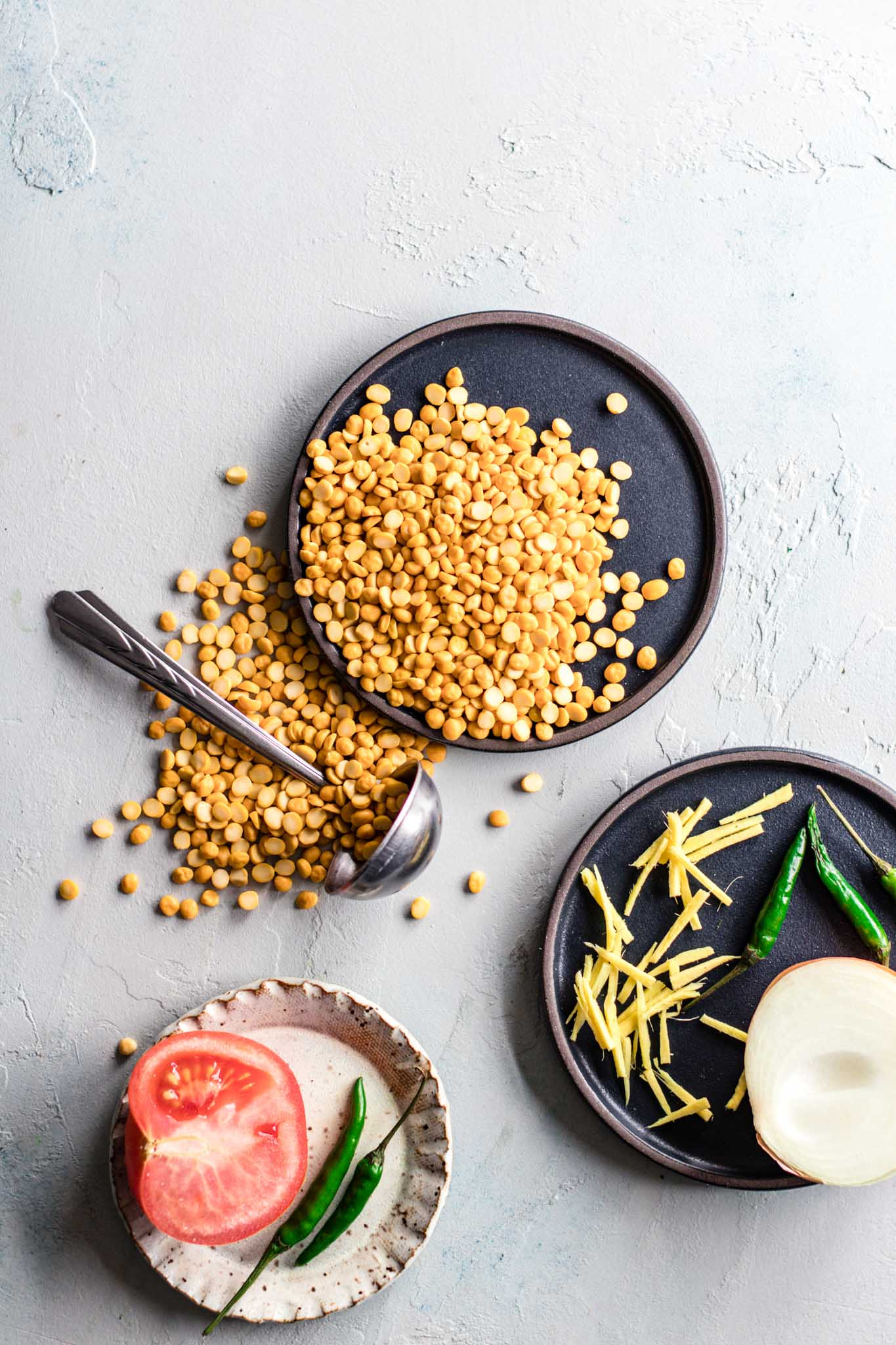 Raw Chana Dal, tomato, onion, green chili peppers, julienned ginger for chana dal recipe