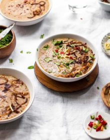 Beef Haleem in a bowl garnished with ginger and cilantro