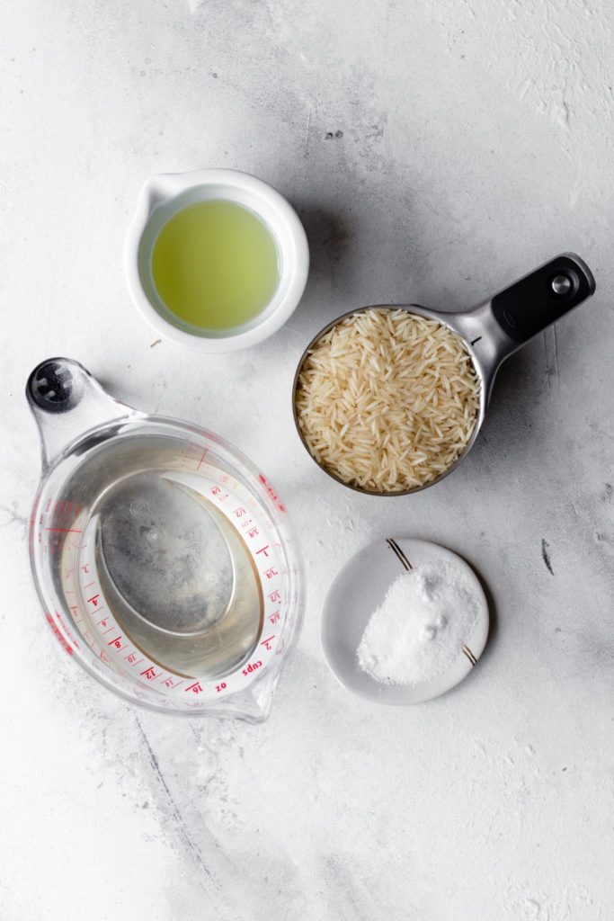 Basmati rice, oil, salt and water to make basmati rice in a rice cooker