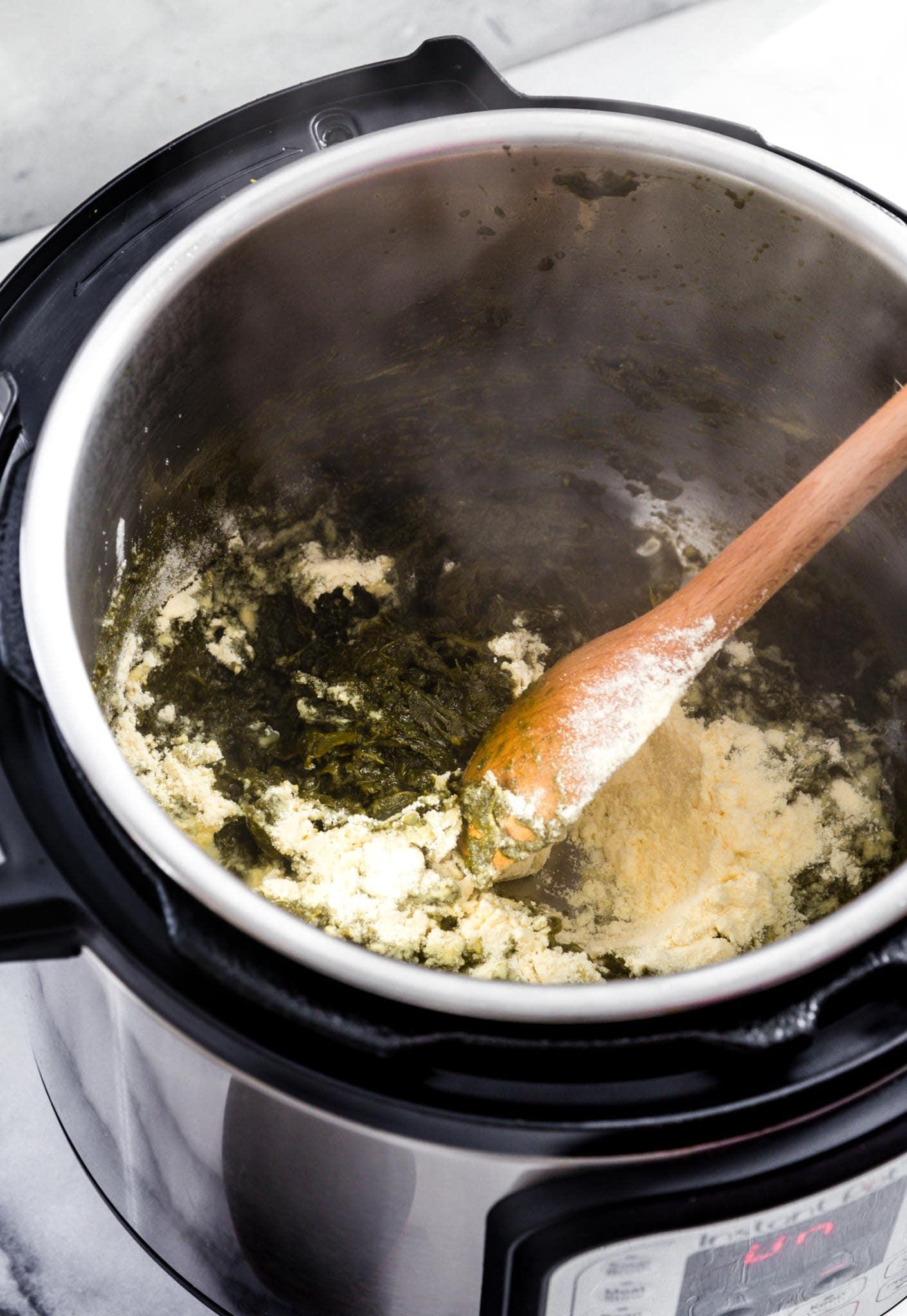 Sauteing corn flour to make Instant Pot Sarson Ka Saag