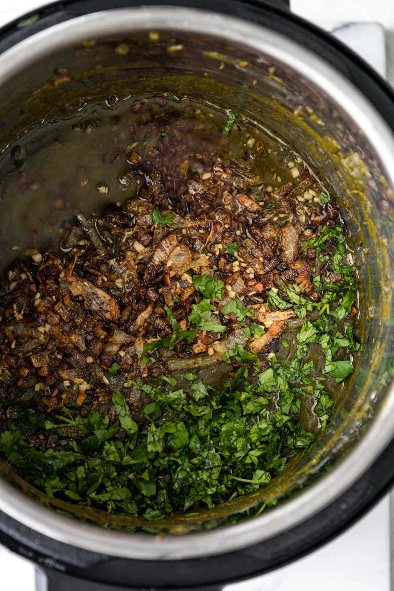 Tadka added to instant pot Sarson Ka Saag along with chopped cilantro