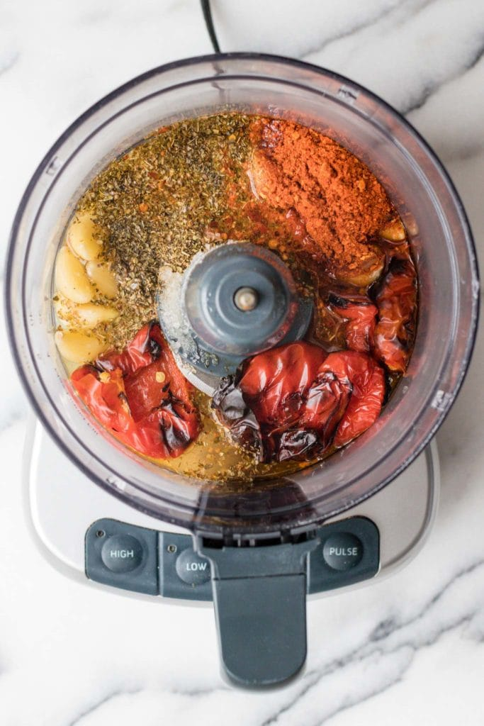 Ingredients for Peri Peri Sauce in a food processor ready to be blended