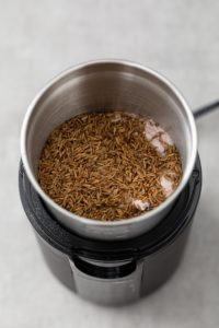 Spices in a spice grinder ready to be ground