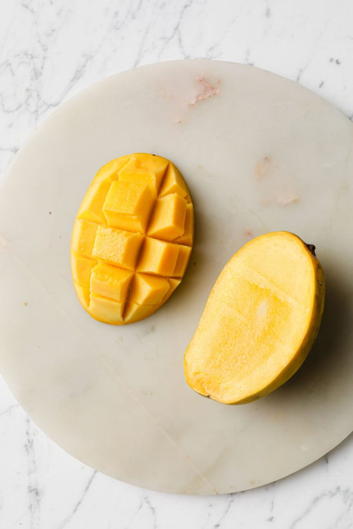 A mango slice cubed and ready to be spooned